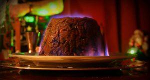 Flaming traditional Christmas pudding the south of England