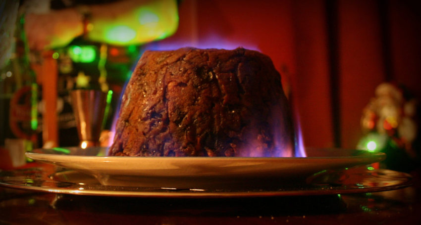 Flaming traditional Christmas pudding the south of England
